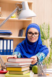 The muslim girl preparing for entry exams Stock Photos