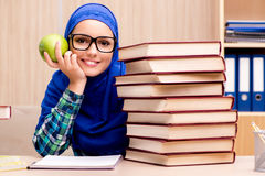 The muslim girl preparing for entry exams Stock Image