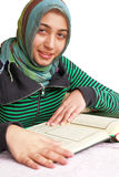 Muslim girl read the holy Koran. Muslim girl reads the holy Koran on white background stock image