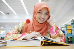 Muslim girl reading book royalty free stock image