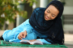 Muslim Girl Reading Koran Royalty Free Stock Images