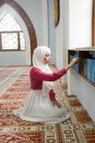 Muslim girl reading Koran Royalty Free Stock Photo