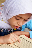 Muslim girl reads the holy Koran