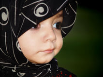 Muslim girl with scarf. Muslim girl wearing a traditional scarf on her head while looking away Royalty Free Stock Photography