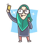 Muslim girl selfie. A cute young muslim girl get selfie with star background at night wearing tudung and spectacle showing peace sign Stock Image
