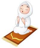 Muslim girl sitting on the prayer rug while praying. Illustration of Muslim girl sitting on the prayer rug while praying Stock Photography