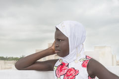 Muslim girl on a terrace, side view, ten years old Stock Photo