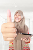 Muslim girl using tablet computer Stock Photo