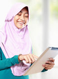 Muslim girl using tablet computer Royalty Free Stock Image