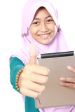 Muslim girl using tablet computer Royalty Free Stock Images