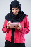 Muslim girl using tablet Stock Images