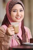 Muslim girl was breakfast Stock Photos