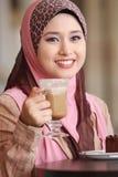 Muslim girl was breakfast. Beautiful muslim girl was breakfast Stock Photos