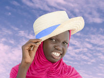 Muslim girl wearing a straw hat at dawn, ten years old Stock Image