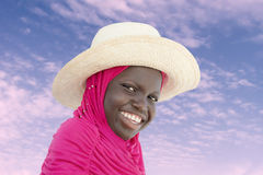 Muslim girl wearing a straw hat at dawn, ten years old Stock Photography