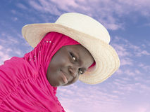 Muslim girl wearing a straw hat at dawn, ten years old Stock Images
