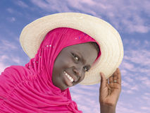 Muslim girl wearing a straw hat at dawn, ten years old Royalty Free Stock Photos