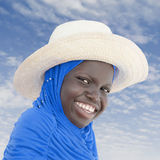 Muslim girl wearing a straw hat, ten years old Stock Image