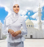 Muslim girl on white mosque background Royalty Free Stock Photography