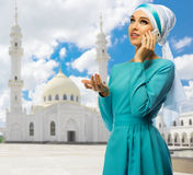 Muslim girl on white mosque background Stock Photo