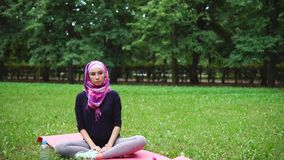 Muslim girl working out in the park stock video footage