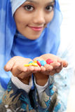 Muslim girls with chocolate. A young muslim girls with a colored chocolate Royalty Free Stock Images