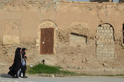 Muslim girls. A group of muslim girls passing by an old wrecked building in Iran Royalty Free Stock Photos