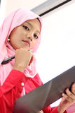 Muslim girls holding a report file. A young beautiful muslim girls holding a report file Stock Image