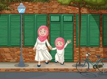 Muslim girls on the sidewalk Royalty Free Stock Images