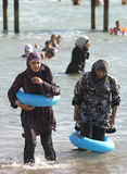 Muslim Girls Swimming Stock Images