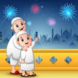 Muslim grandfather with his grandson celebrate for eid mubarak Stock Photography