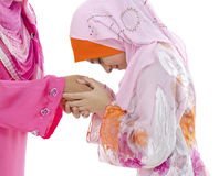 Muslim greeting. Young Muslim women greeting to elders royalty free stock images