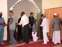 Muslim greetings in  African mosque. Muslims greet each other after prayers in Kenya Stock Images