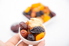 Muslim hand presenting collection of Ramadan dried fruits Stock Images