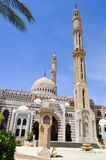 Muslim Islamic Mosque for the gathering of Muslims for general prayer, a liturgical architectural structure with high towers, dome. S and spiers against the blue Royalty Free Stock Photography