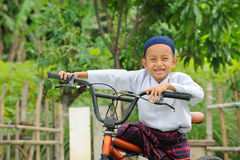 Muslim Kid on Bicycle Stock Photo