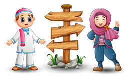 Muslim kid couple and blank wood arrow sign