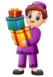 Muslim kid holding gift box wearing red clothes Royalty Free Stock Photos
