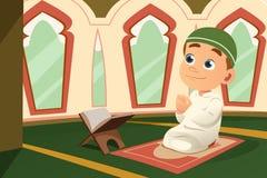 Muslim Kid Praying in Mosque Stock Images