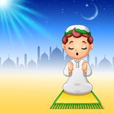 Muslim kid sitting on the prayer rug while praying. Illustration of Muslim kid sitting on the prayer rug while praying Stock Photos