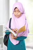 Muslim kid student reading book Stock Photo