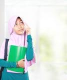 Muslim kid student thinking Stock Photo