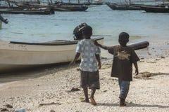 Muslim kids on the beach Stock Photos