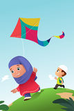 Muslim Kids Playing Kite Outdoor Stock Image