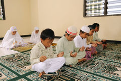 Muslim Kids Praying royalty free stock image