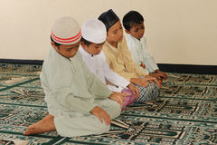 Muslim Kids Praying Royalty Free Stock Photo