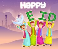 Muslim kids wishing Happy Eid Stock Photos