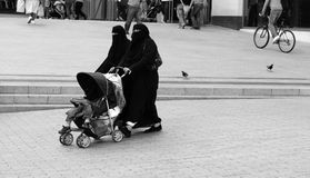 Muslim Ladies out for a walk. Muslim Ladies out shopping in the city in full traditional clothing Stock Image