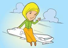 Muslim lady on flying plane Royalty Free Stock Image