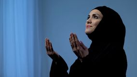 Muslim lady raising hands to sky, blessing God, islamic religious traditions. Stock photo royalty free stock photography